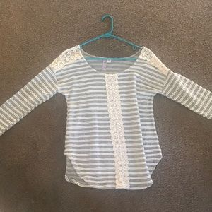 Francesca's striped mid-length top.